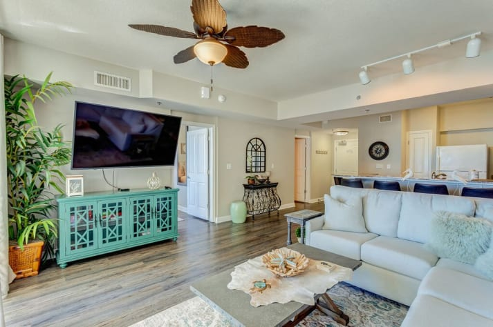 Living area with large, flat- screen TV, ceiling fans and amazing views!