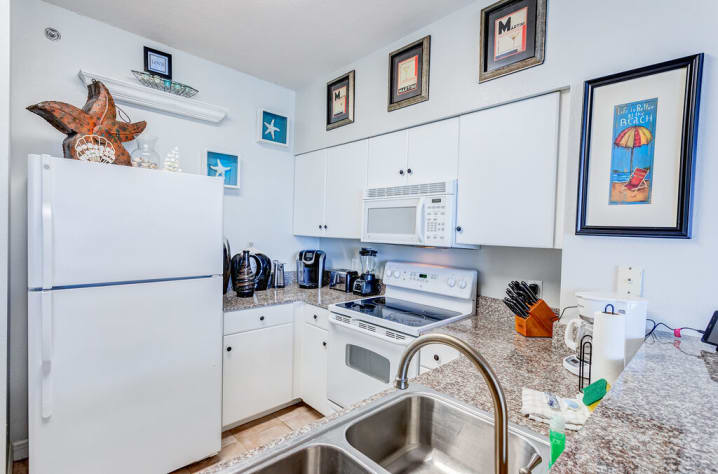 All White Kitchen with Granite Counters