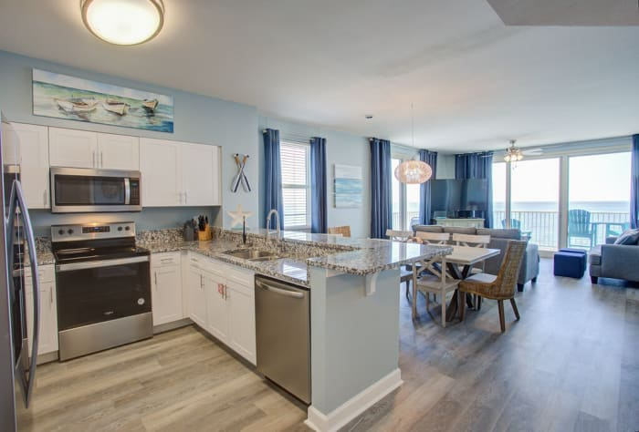 Stainless Steel Appliances, Granite Counters and White Cabinetry