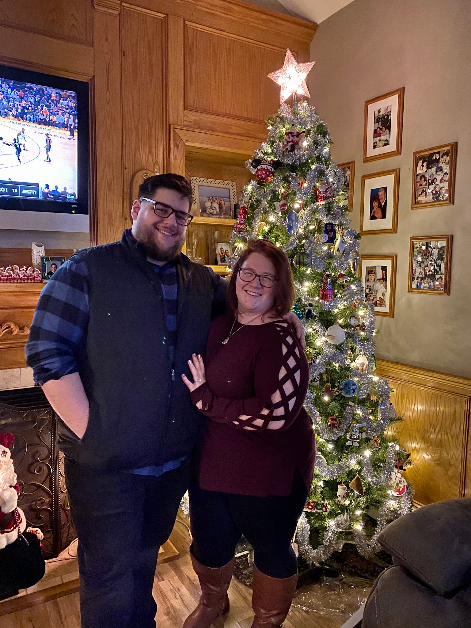 Meg and Ryan in front of a christmas tree