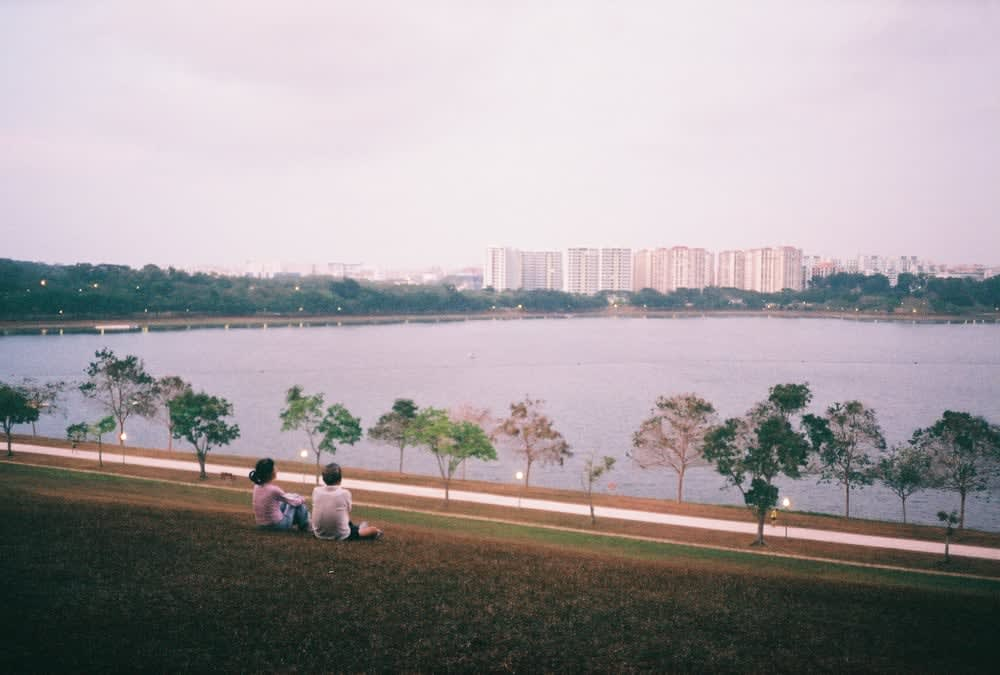 Couple talking at Bedok reservoir Singapore
