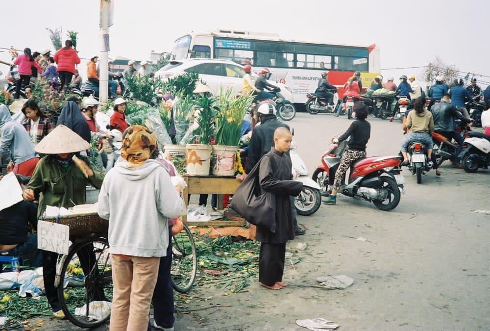 monk standing at flower market