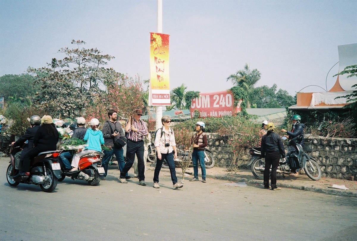 people walking at flower market Hanoi