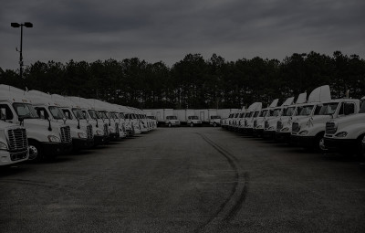 Semi tractors parked in lot