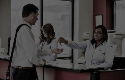 Customer talking to Rental manager