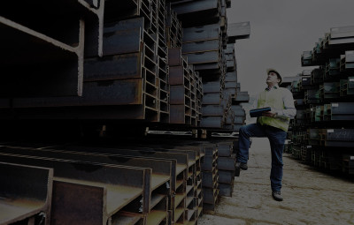 Worker looking at Pallets