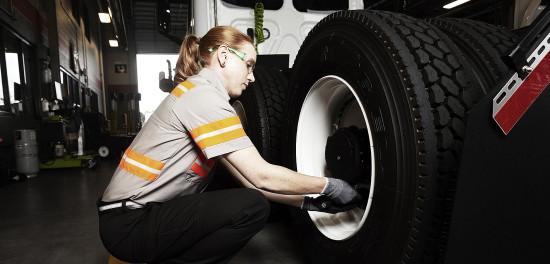Female technician servicing a truck