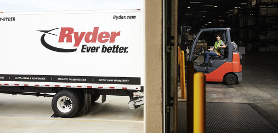 Loading bay with truck on outside and forklift on inside