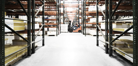 Warehouse with racks and forklift