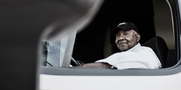 Truck Driver Sitting in His Truck Smiling