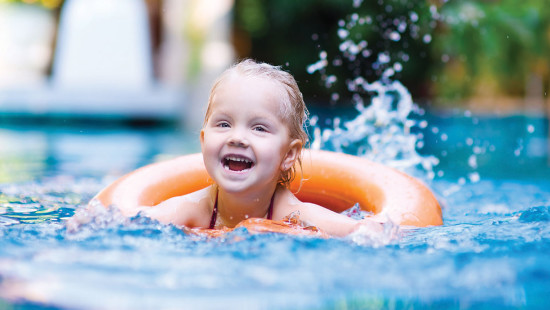 Child swimming with inner tube