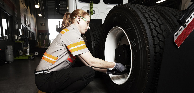 Female technician servicing a truck