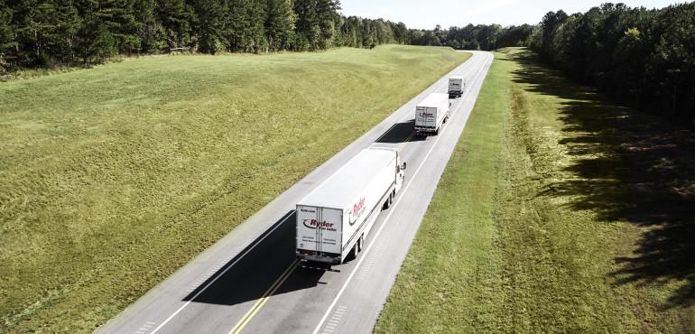 Three trucks on rural road