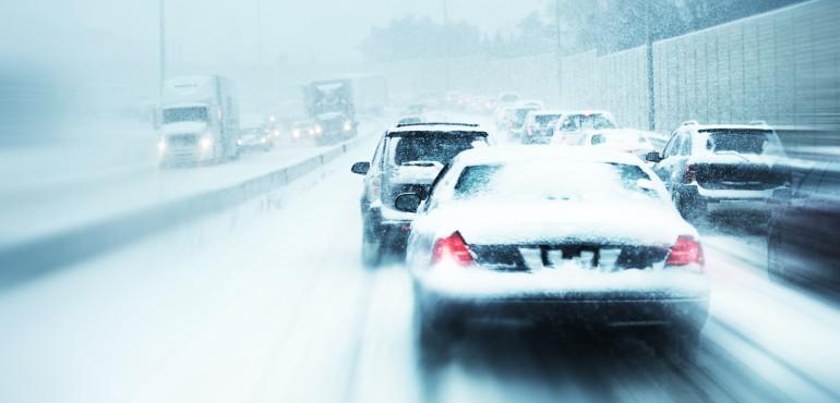 Highway traffic in winter snow storm