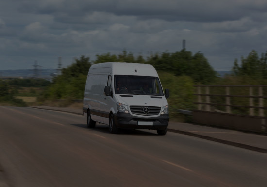 Van in transit on road with motion blur