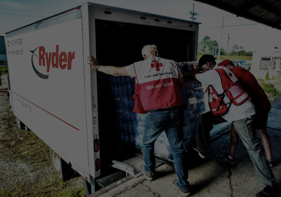 Red Cross volunteers loading back of Ryder Truck