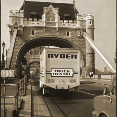 Back view of a Ryder Rental Truck driving