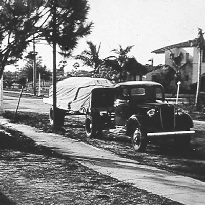 1940s Ryder Truck with covered trailer on the road