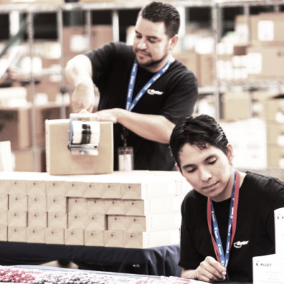 Warehouse workers packaging boxes