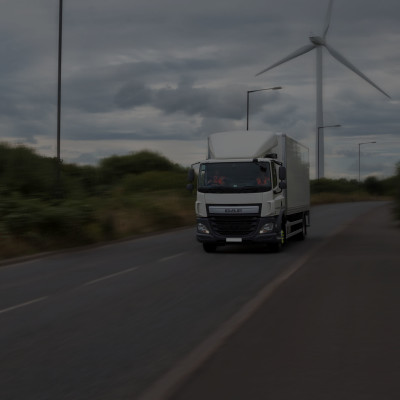 Ryder vehicle with wind turbine in background