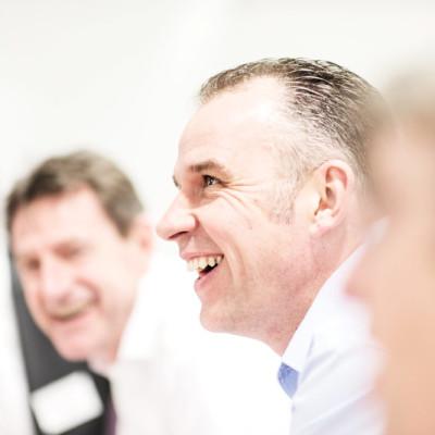 Laughing Ryder employee in sales meeting