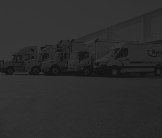 Commercial vehicles lined up next to each other