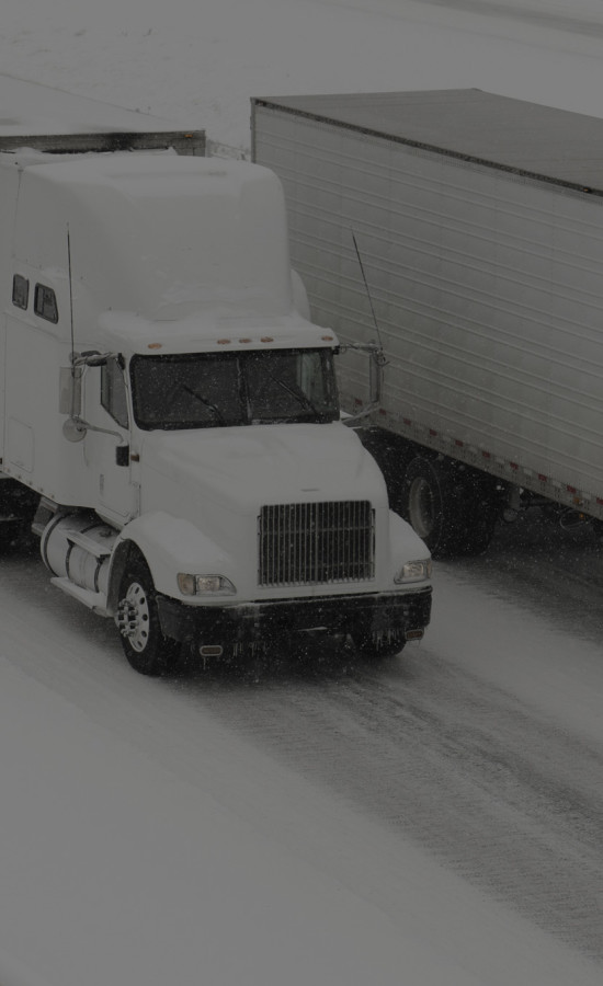 Truck Driving on snow covered road