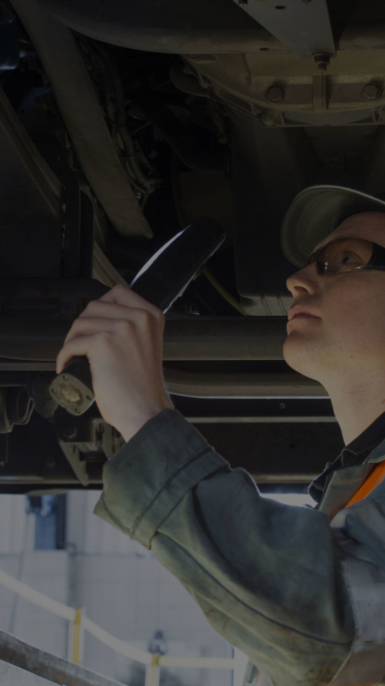 Ryder technician working underneath a cab