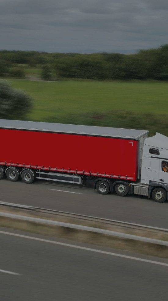 Ryder red rental trailer on motorway with motion blur