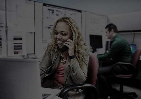 Employee at her desk talking on the phone