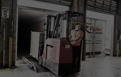 Forklift loading back of truck
