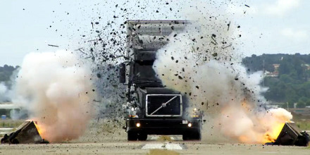 Truck getting blasted with dirt