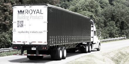Truck with Royal branding driving on the road