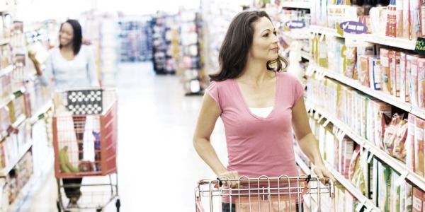 Women with shopping cart in grocery store