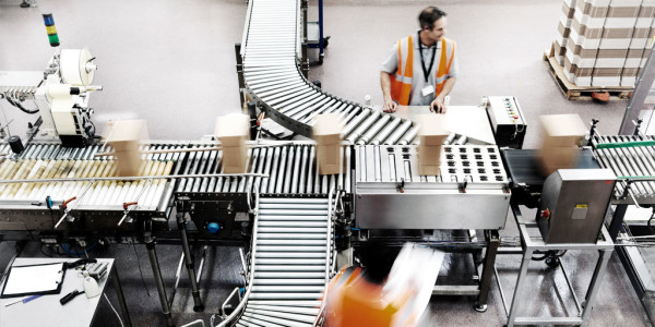 Warehouse worker on picking and packing line