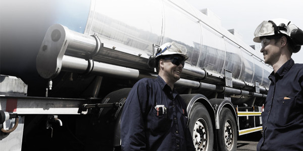 Truck technicians standing by oil truck