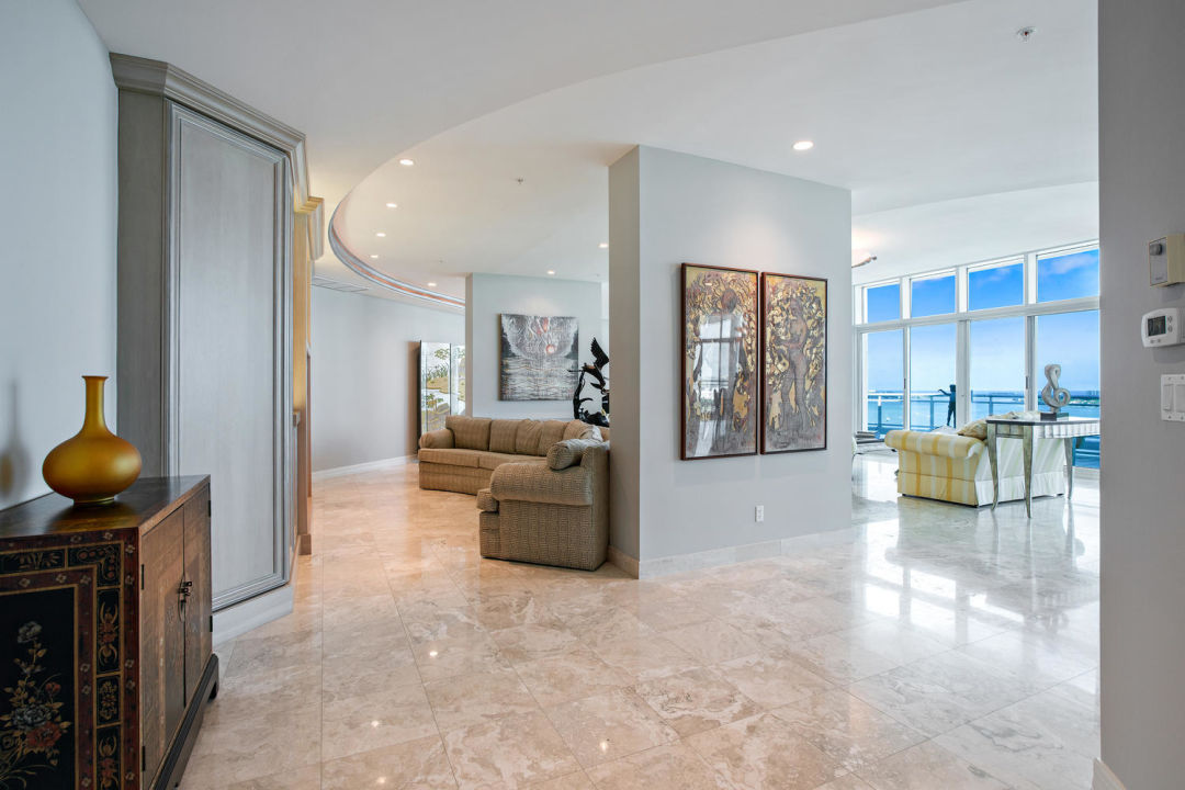 Foyer and living area in Sarasota penthouse