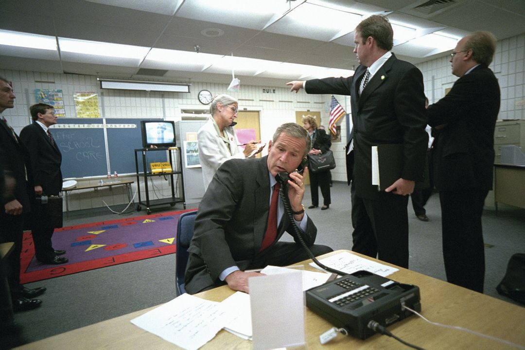 George W. Bush with White House aides and journalists in Emma E. Booker Elementary School's temporary media center.