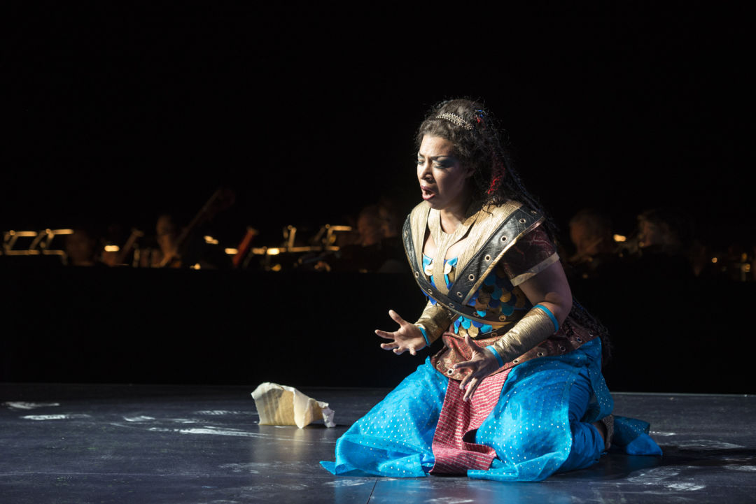 An actress kneels onstage at the Seattle Opera.