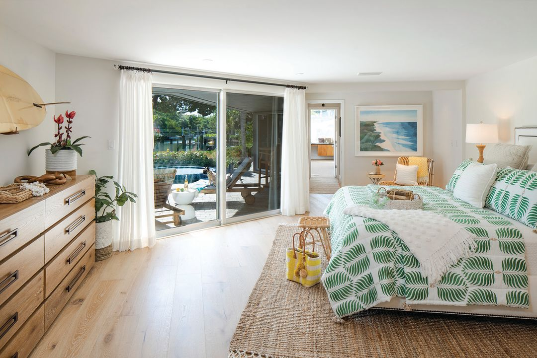 The master bedroom offers a floor-to-ceiling view of the outdoors.