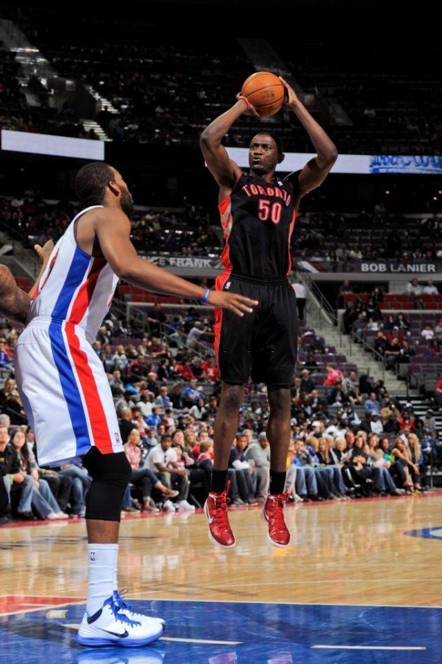 Solomon Alabi shoots a basketball in the NBA.