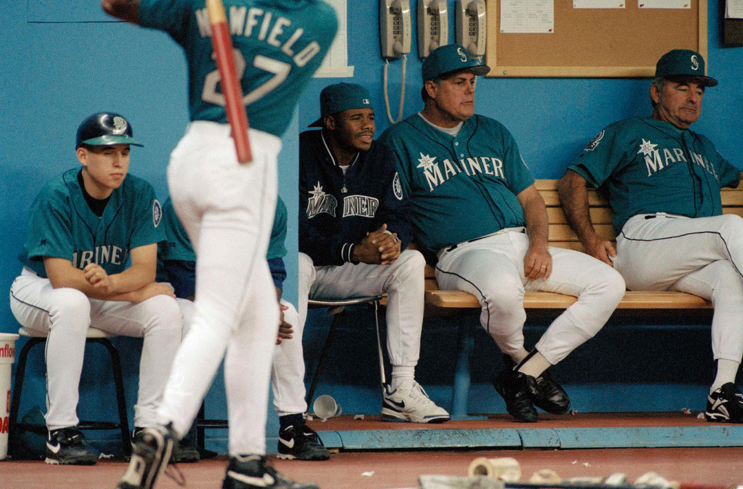 981ec16186 Ken Griffey Jr. sits in the dugout next to manager Lou Piniella, June 1995.
