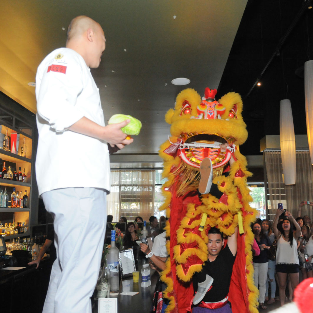 Lion dancer performers with chef bgyblg