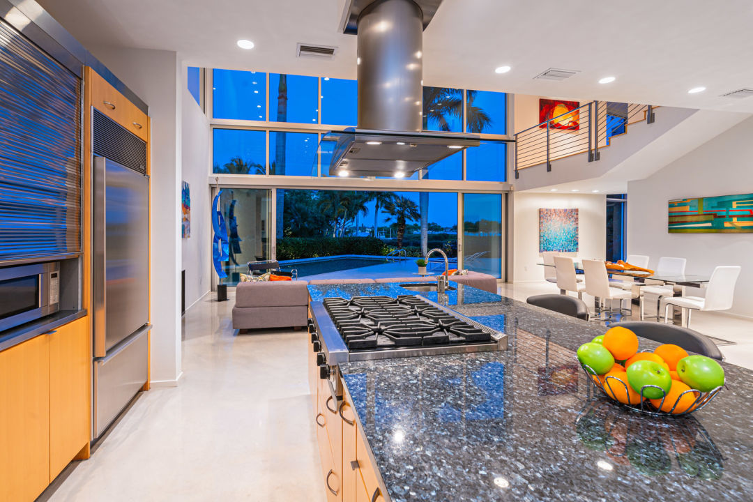A kitchen island with marble countertop