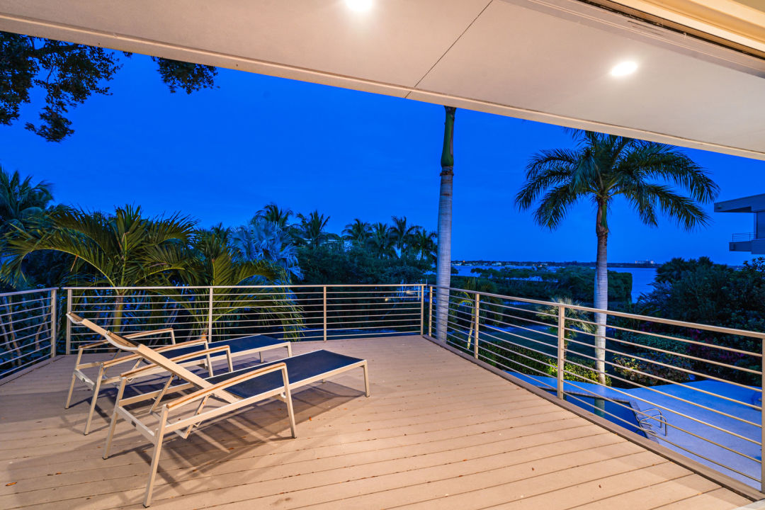 Siesta Key home outdoor deck with chaise lounges
