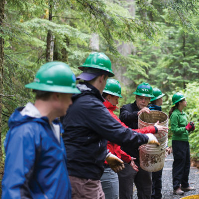 Teamwork on a washington trails association work party at franklin falls. photo by erik haugen goodman lq2dzd