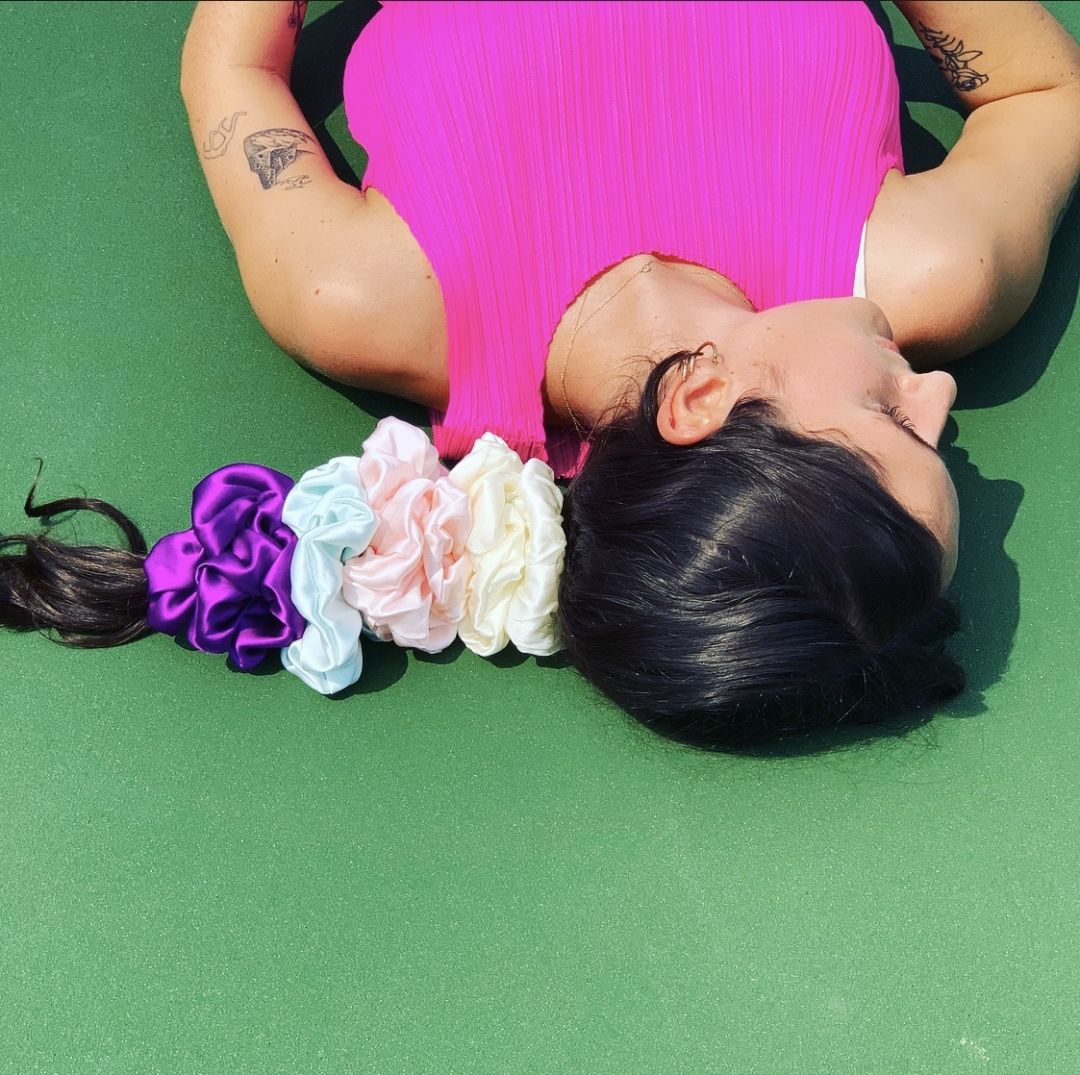 Callan Malone wears Sparkle Diva's Opulent Silk Scrunchies