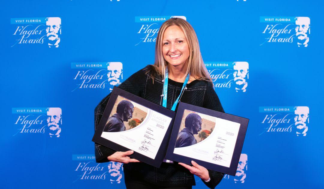 Erin Duggan accepts Visit Sarasota County's two Visit Florida marketing awards.