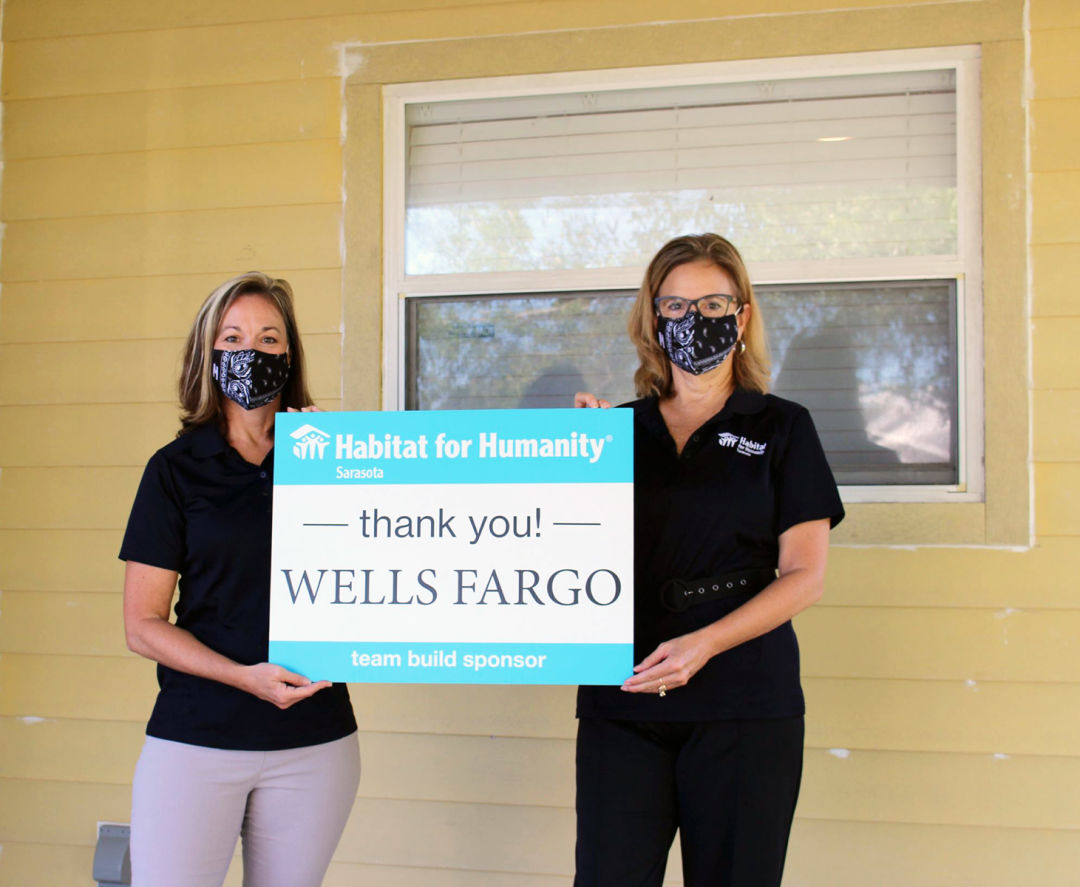 Renee Snyder, President and CEO, with Rhonda Leiberick, Program Director, for Habitat for Humanity Sarasota, in front of the home supported by Wells Fargo Builds℠.