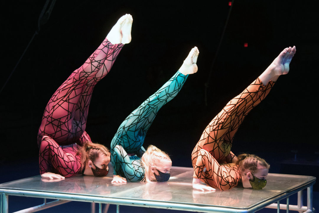 Rylee Grover, Addi VonWowern and Destiny Overholt practice a contortion routine